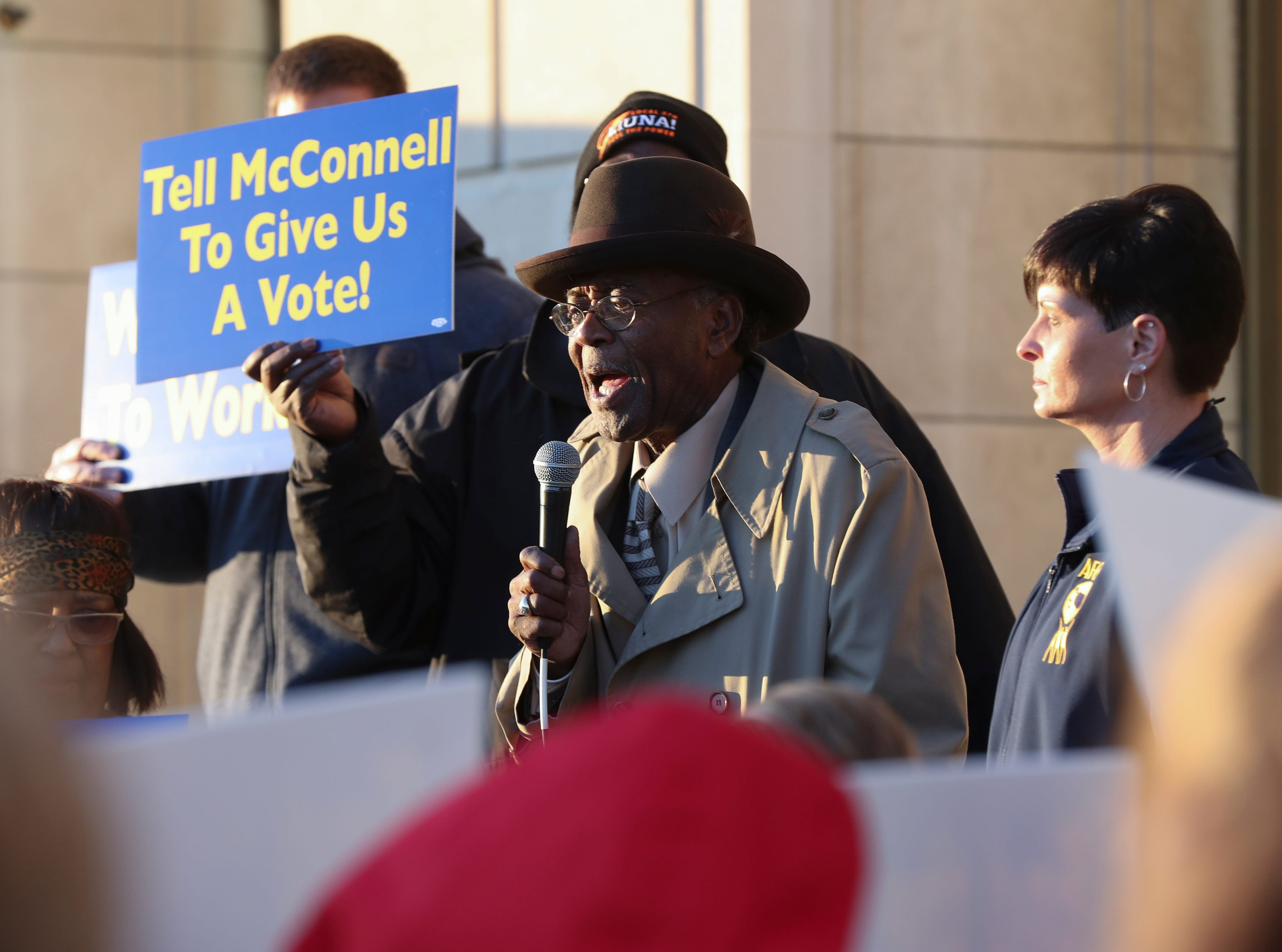 The Rev. Charles Elliott spoke to a group of protesters, mostly comprised of Jeffersonville Census Bureau employees, who were rallying against the government shutdown.