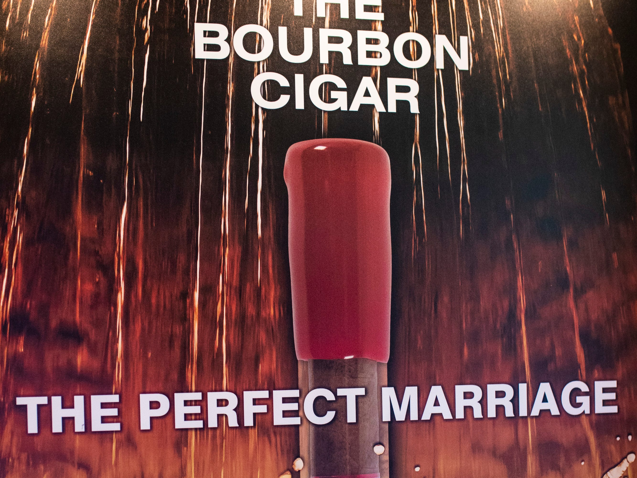 """A marketing ad created by Ted Jackson's company Ted's Cigars for their """"Bourbon Cigar."""" The Louisville company set about rebranding to differentiate from their previous Maker's Mark cigar once an agreement ended in 2016. Maker's Mark filed a suit Tuesday saying Jackson is infringing on their trademark, while Jackson is countersuing over issues related to dipped wax use rights. Jan. 10, 2019"""