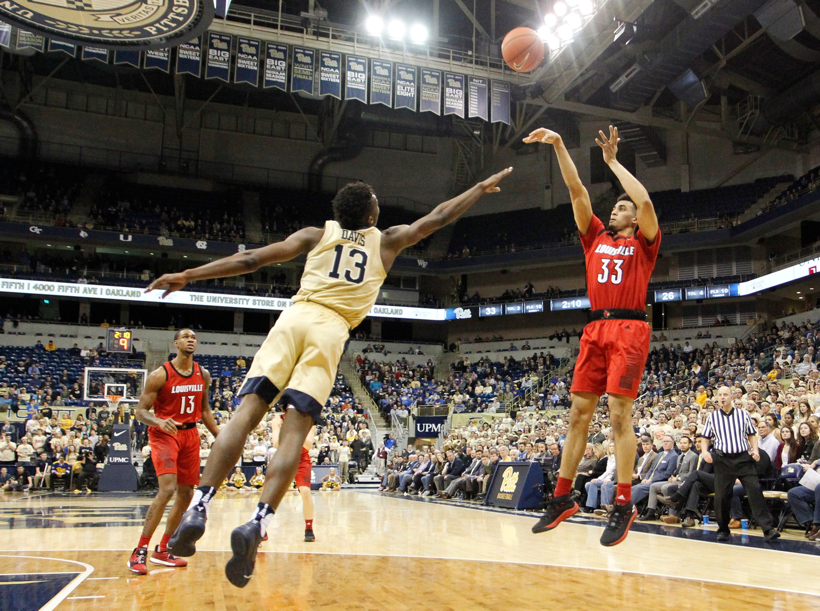 Jan 9, 2019; Pittsburgh, PA, USA;  Louisville Cardinals forward Jordan Nwora (33) shoots against Pittsburgh Panthers guard Khameron Davis (13) during the first half at the Petersen Events Center.