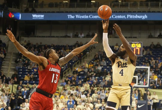 Jan 9, 2019; Pittsburgh, PA, USA;  Pittsburgh Panthers guard Jared Wilson-Frame (4) shoots against Louisville Cardinals forward V.J. King (13) during the first half at the Petersen Events Center.