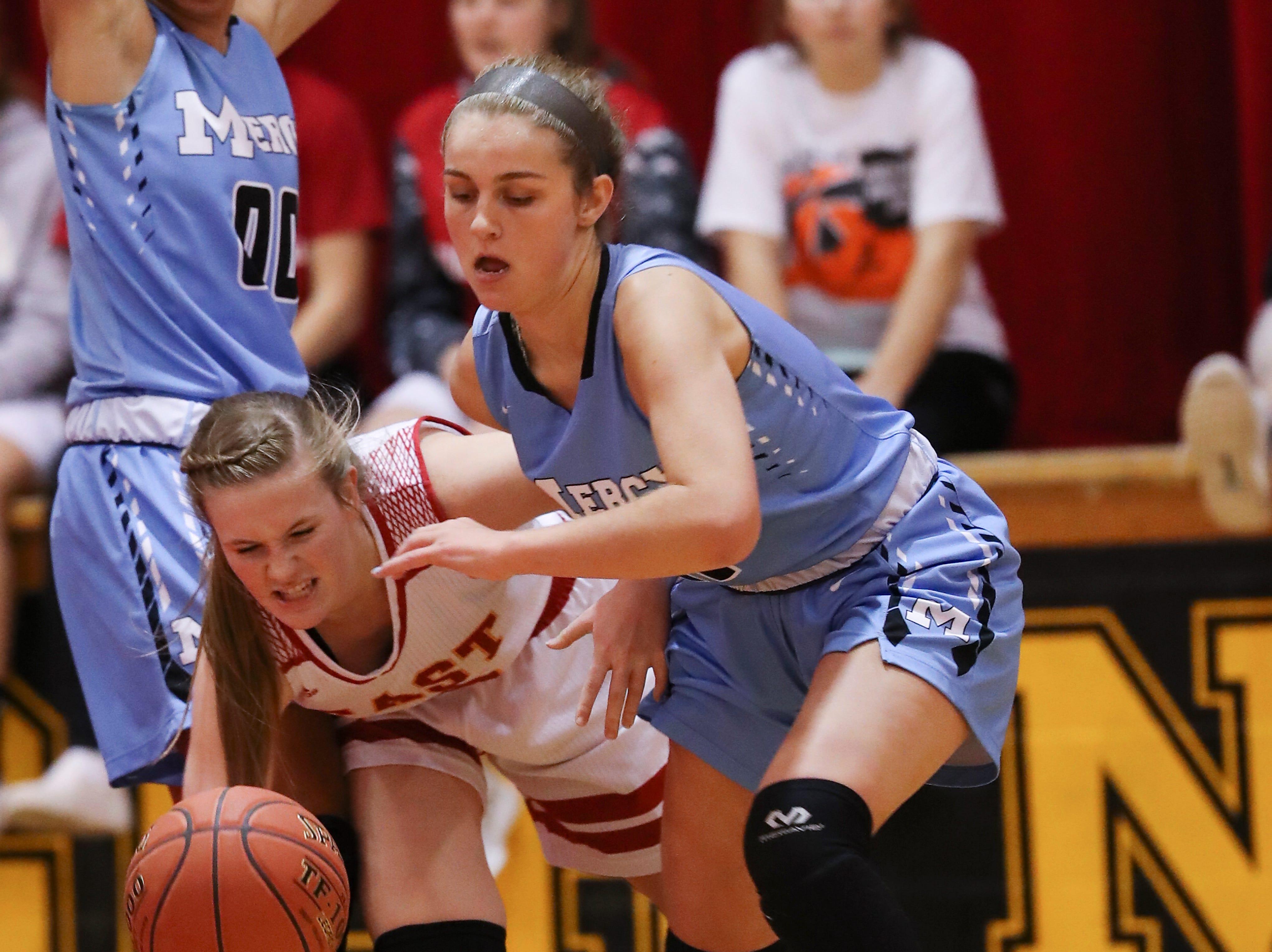 Mercy's Paige Taylor (11) chased a loose ball against Bullitt East's Lexi Taylor (15) at the Bullitt East High School.Jan. 9, 2019