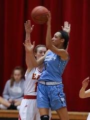 Mercy's Taziah Jenks (1) passed against Bullitt East's Lexi Taylor (15) at the Bullitt East High School.Jan. 9, 2019