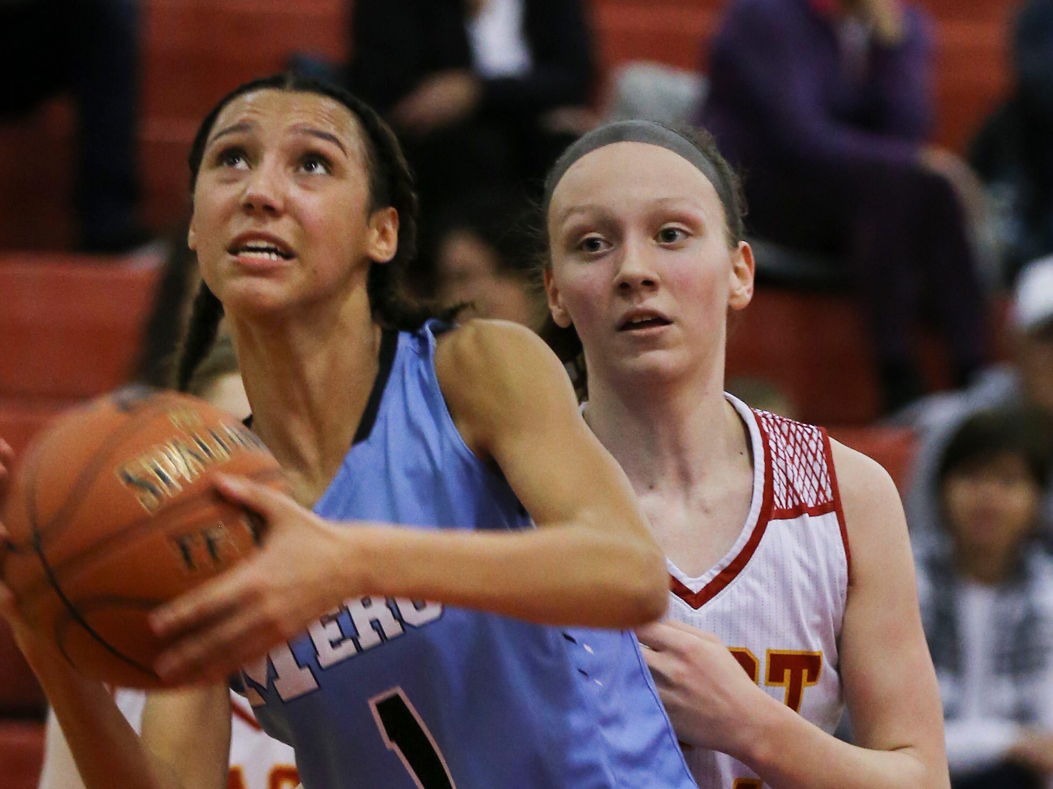 Mercy's Taziah Jenks (1) got past the defense as she made a move towards the basket against Bullitt East at the Bullitt East High School.Jan. 9, 2019