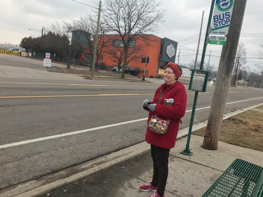 Kate Baughman, 75, waits for a bus Jan. 8, 2019 on Shiawassee Street. She was injured on Spec-Tran bus Dec. 10 when the driver took off before she was in her seat and belted.