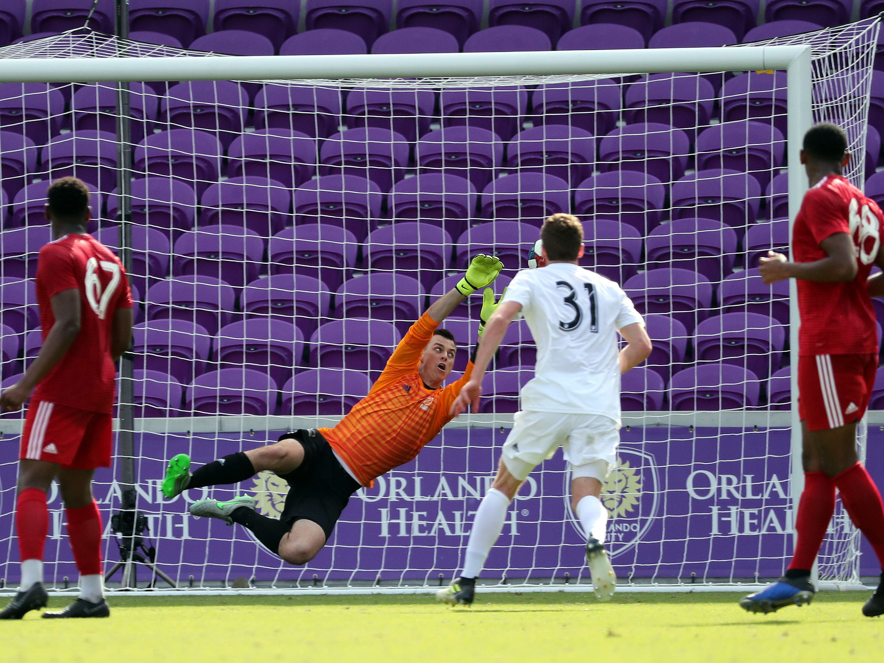Team Predator goalkeeper Jimmy Hague (11) makes a save during the first half at Orlando City SC Stadium.