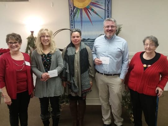 Manitowoc Lakeshore Unitarian Universalist Fellowshipmade donations to five local aid organizations in December. Pictured:Kathy Bernhart, LUUF treasurer;Jennifer Schmuldt, Painting Pathways Clubhouse; Jamie Hayes from Hope House; Jason Granger, InCourage; and Cecelia Held, LUUF vice president.