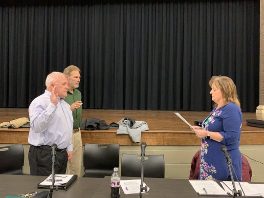 John Luedy and Jeff Meyers are sworn in as Madison School Board Vice-President and President, respectively, January 9, 2019.