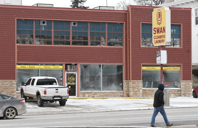 The Swan Cleaners sign has been in place since 2014, after the original sign was damaged when a car hit it.