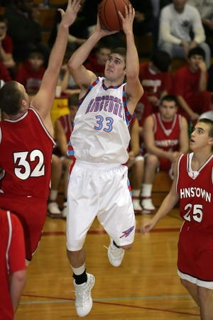 Ridgedale's J.R. Weston scores on a jumper and is fouled by Johnny defender Daniel Ulry during the Rockets home game against Johnstown in 2008. Weston is the all-time leading scorer in Marion County history with 1,841 career points.