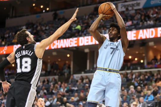 Memphis Grizzlies guard Justin Holiday shoots the ball over San Antonio Spurs defender Marco Belinelli during their game at the FedExForum on Wednesday, Jan. 9, 2019.