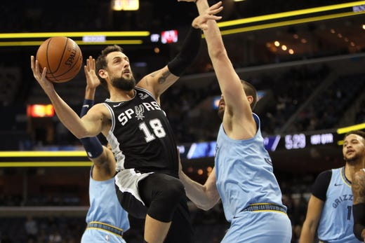 San Antonio Spurs forward Marco Belinelli tries to shoot while being fouled by Memphis Grizzlies center Marc Gasol during their game at the FedExForum on Wednesday, Jan. 9, 2019.