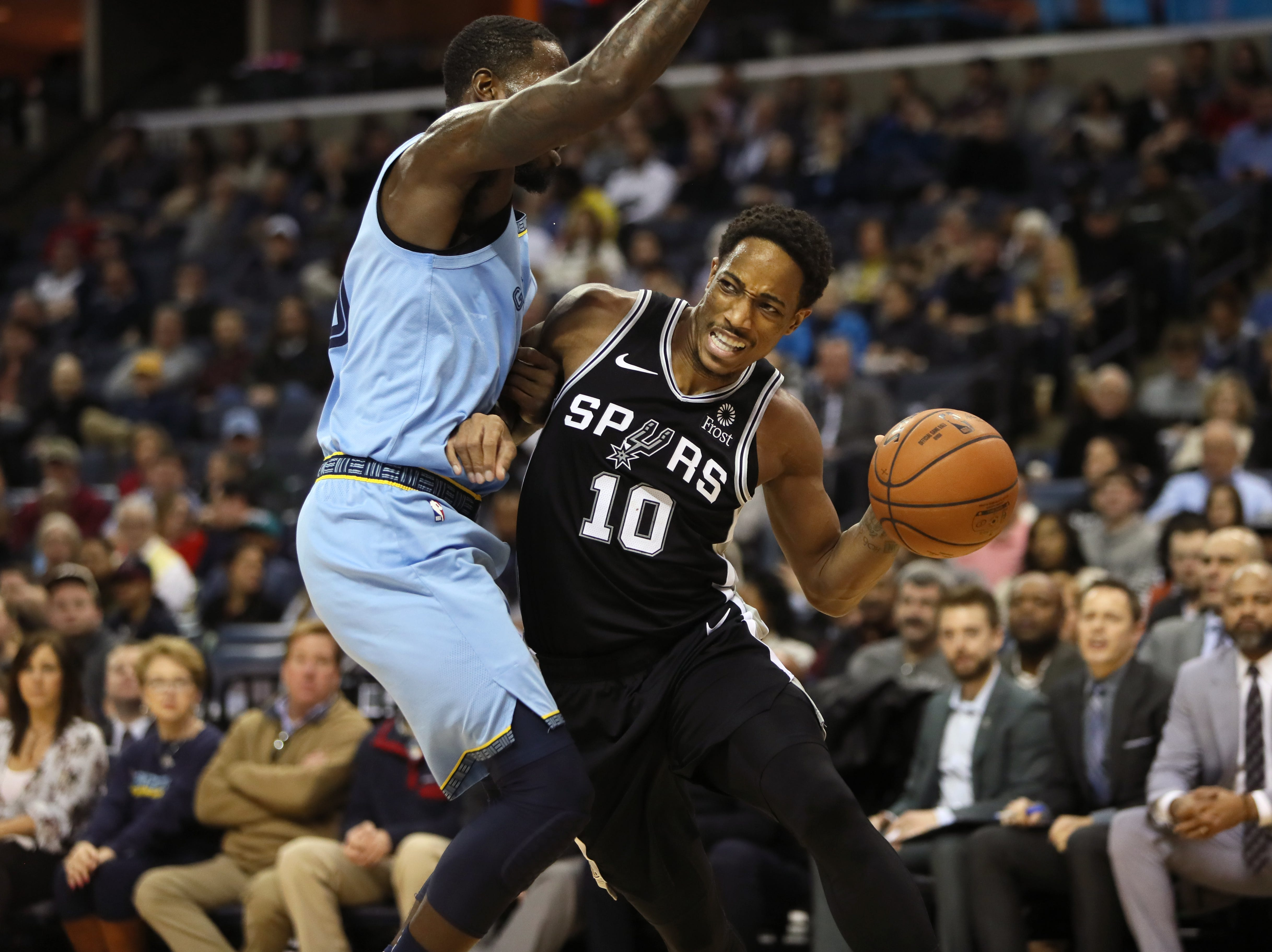 San Antonio Spurs guard DeMar DeRozan drives the baseline past Memphis Grizzlies defender JaMychal Green during their game at the FedExForum on Wednesday, Jan. 9, 2019.