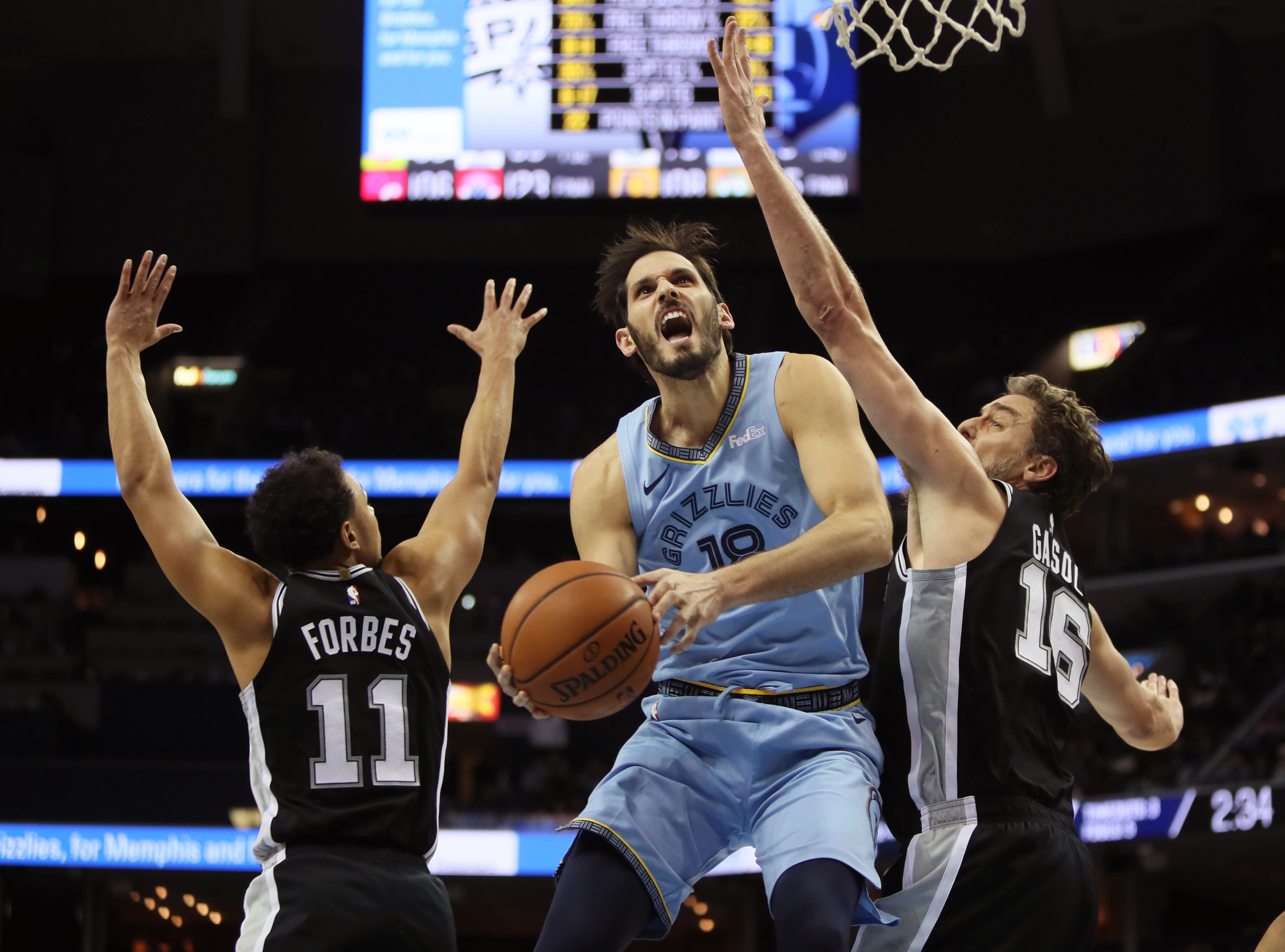 Memphis Grizzlies forward Omri Casspi makes a shot between San Antonio Spurs defenders Bryn Forbes, left, and Pau Gasol during their game at the FedExForum on Wednesday, Jan. 9, 2019.