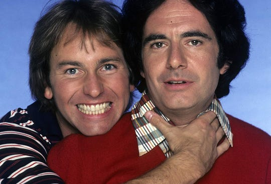 "The choke's on you: John Ritter and Richard Kline in a publicity pose for ""Three's Company."""