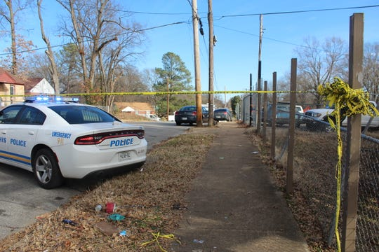 Police tape and a cop car outside of the scene where a double shooting was reported in Southeast Memphis on Imogene Street and Dwight Road.