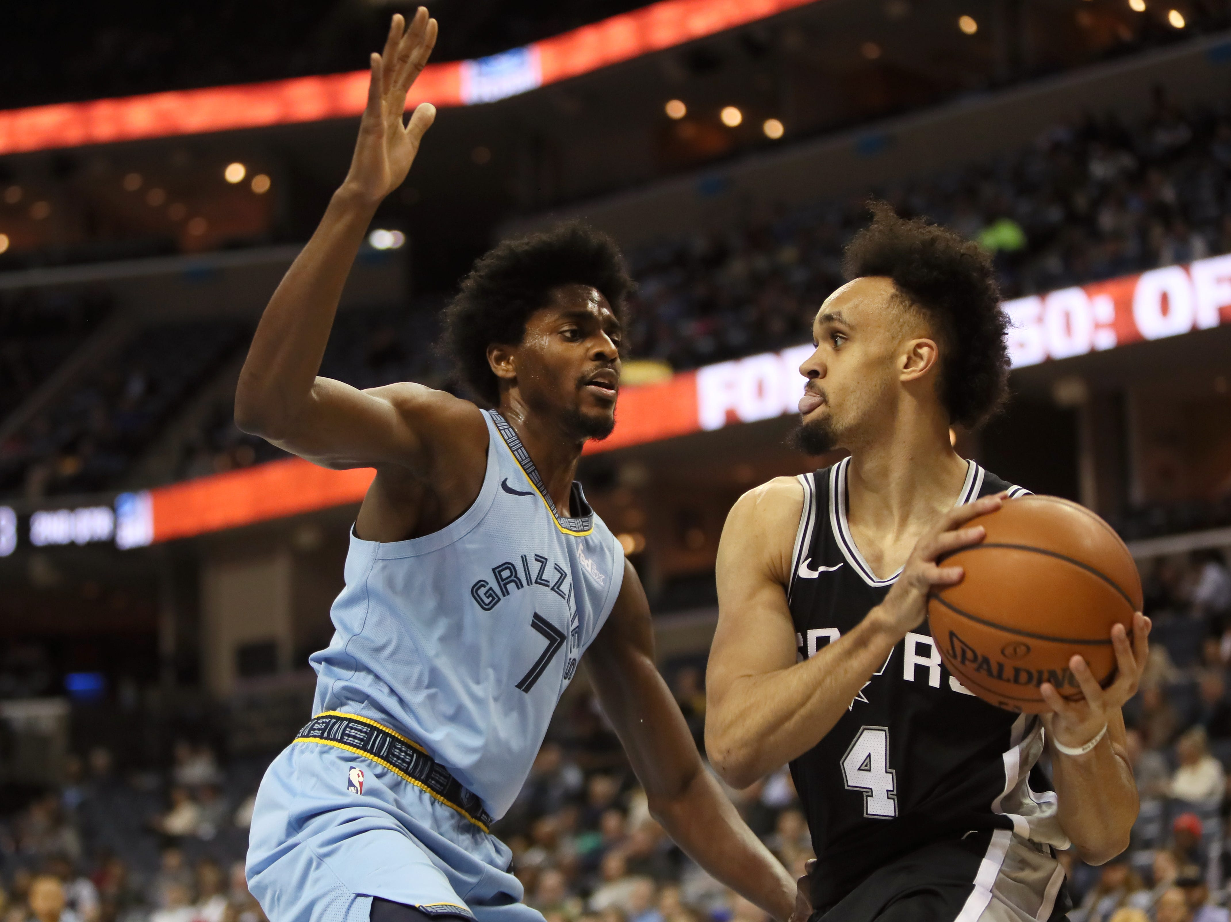 Memphis Grizzlies guard Justin Holiday defends San Antonio Spurs guard Derrick White during their game at the FedExForum on Wednesday, Jan. 9, 2019.