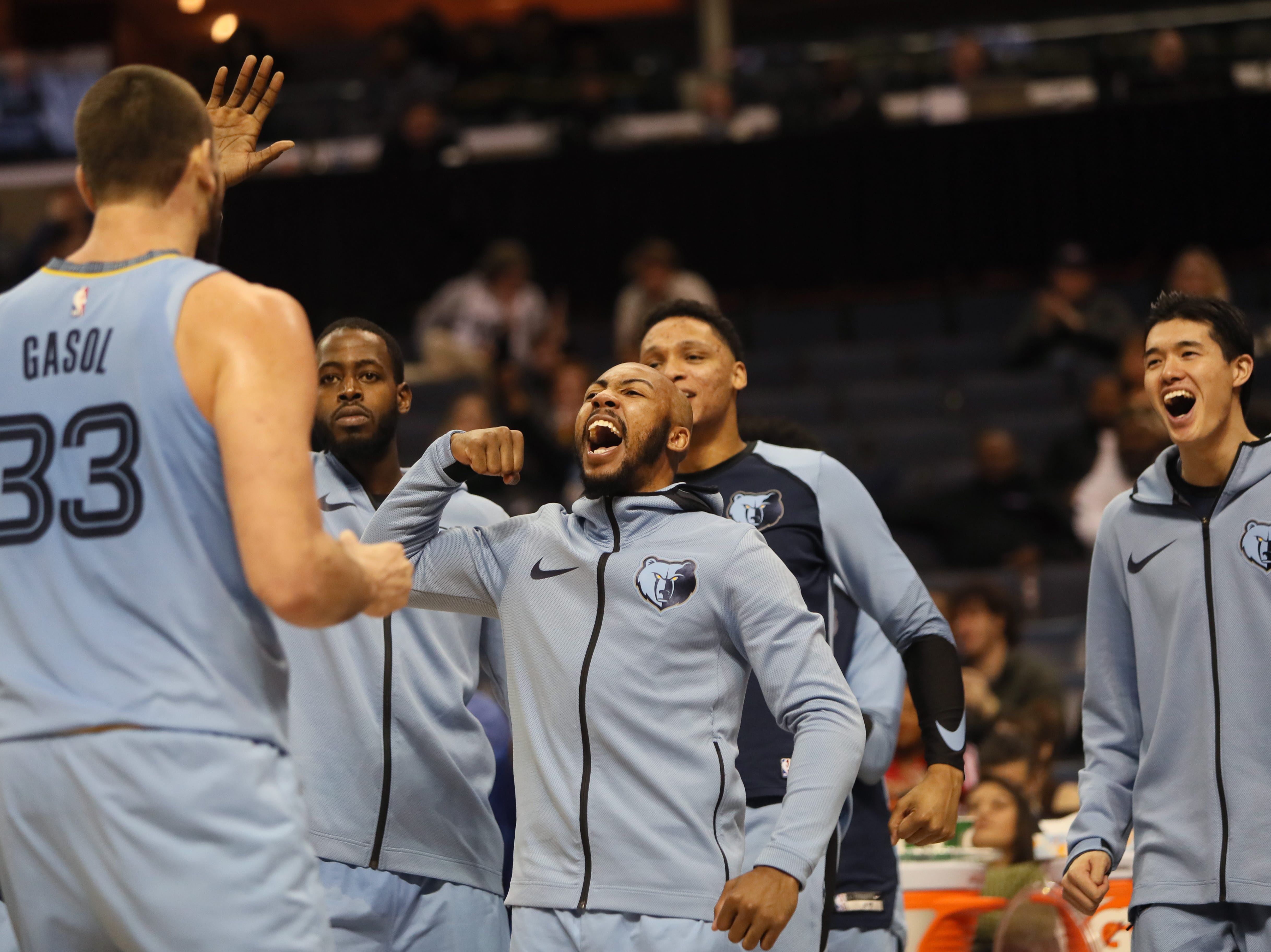 Memphis Grizzlies teammates Jevon Carter and  JaMychal Green congatulate Marc Gasol after a made basket against San Antonio Spurs during their game at the FedExForum on Wednesday, Jan. 9, 2019.