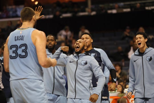 Grizzlies teammates Jevon Carter and JaMychal Green congratulate Marc Gasol after a made basket against Spurs on Wednesday.