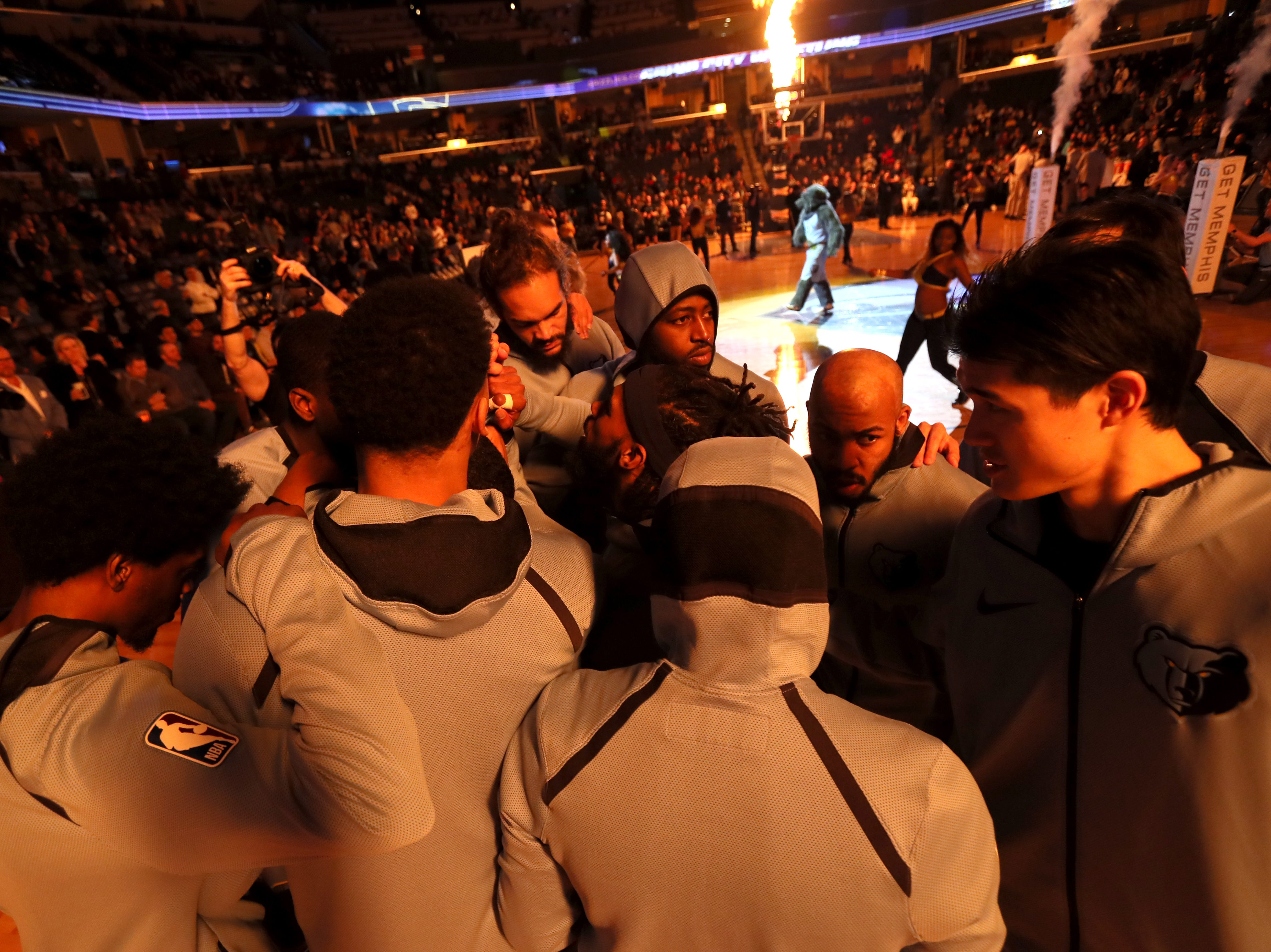 Memphis Grizzlies players huddle up before their game against the San Antonio Spurs at the FedExForum on Wednesday, Jan. 9, 2019.