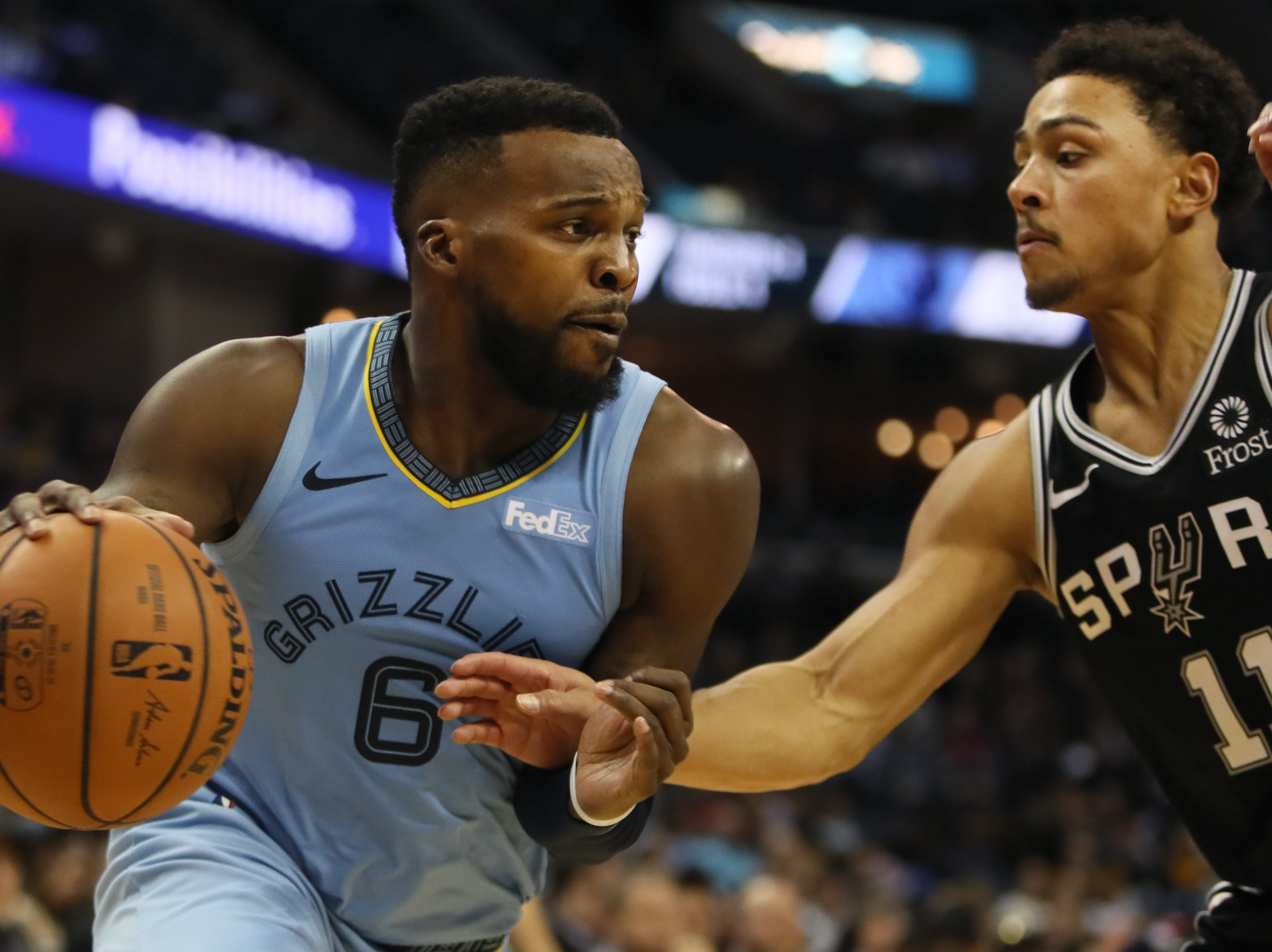Memphis Grizzlies guard Shelvin Mack drives past shoots the ball over San Antonio Spurs defender 	Bryn Forbes during their game at the FedExForum on Wednesday, Jan. 9, 2019.