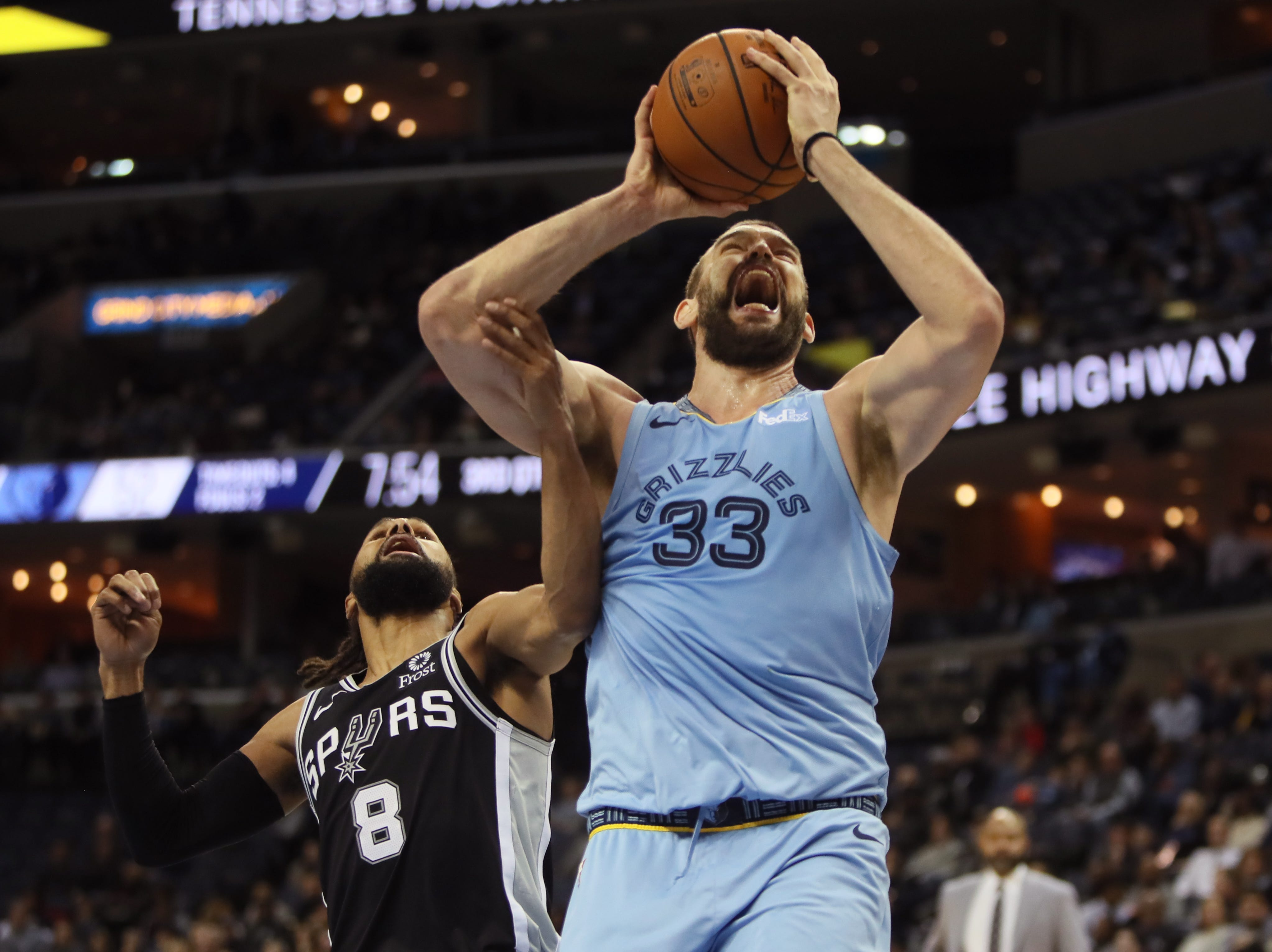 Memphis Grizzlies center Marc Gasol makes a shot while being fouled by San Antonio Spurs defender 	Patty Mills during their game at the FedExForum on Wednesday, Jan. 9, 2019.