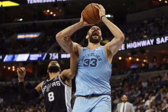 Marc Gasol makes a shot while being fouled by Spurs defender Patty Mills on Wednesday.