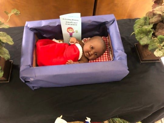 A baby doll in a box was used at Getwell Elementary in a mock funeral to symbolize the burying of poor academic data from the school's past. The incident caused teachers to complain to their union.
