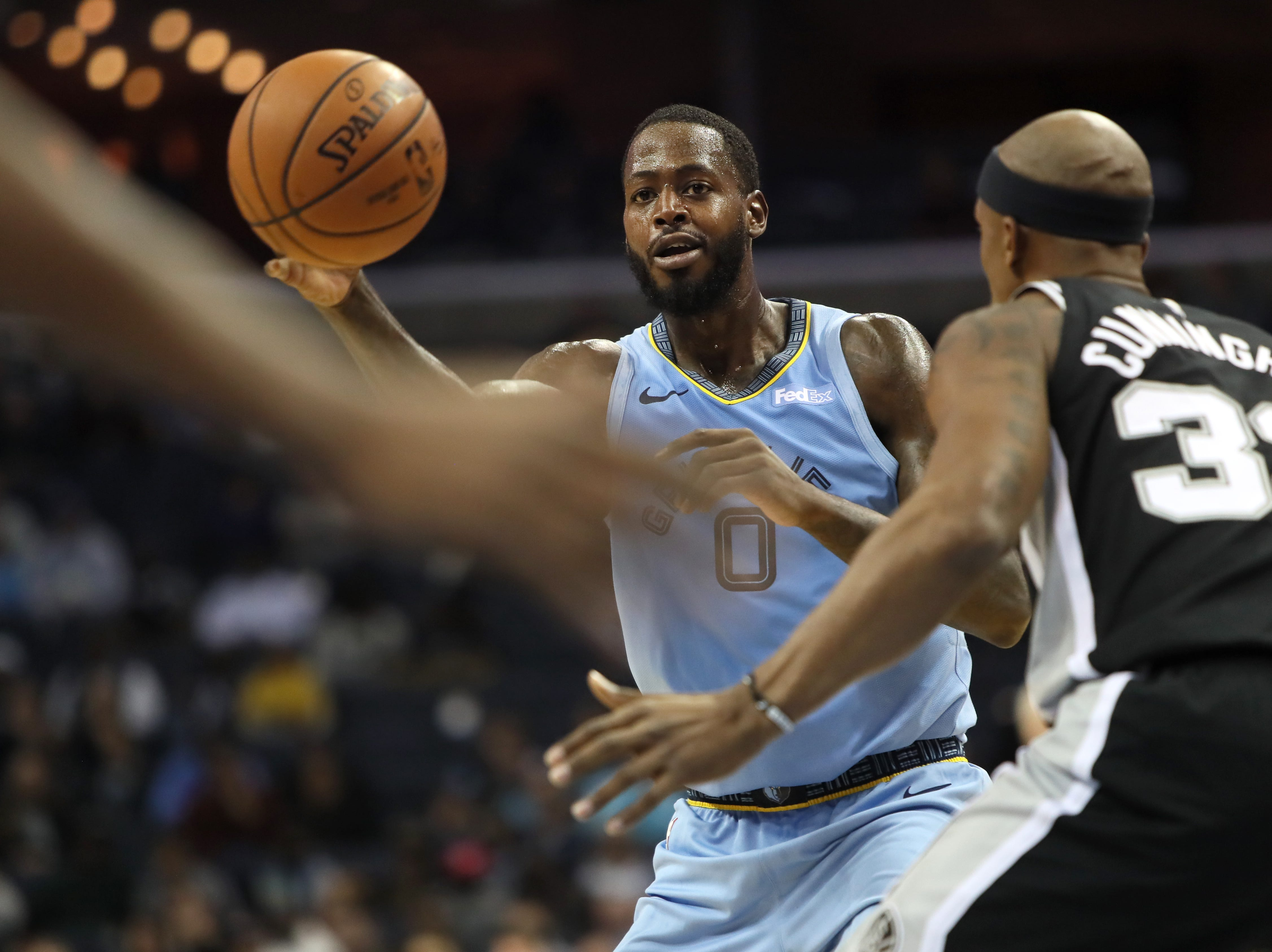 Memphis Grizzlies forward JaMychal Green passes the ball past San Antonio Spurs defender Dante Cunningham during their game at the FedExForum on Wednesday, Jan. 9, 2019.