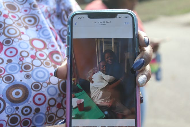 Diedra Ward holds a picture of her brother Ronald Terry after finding out he was a victim of a double shooting in Southeast Memphis Thursday afternoon.