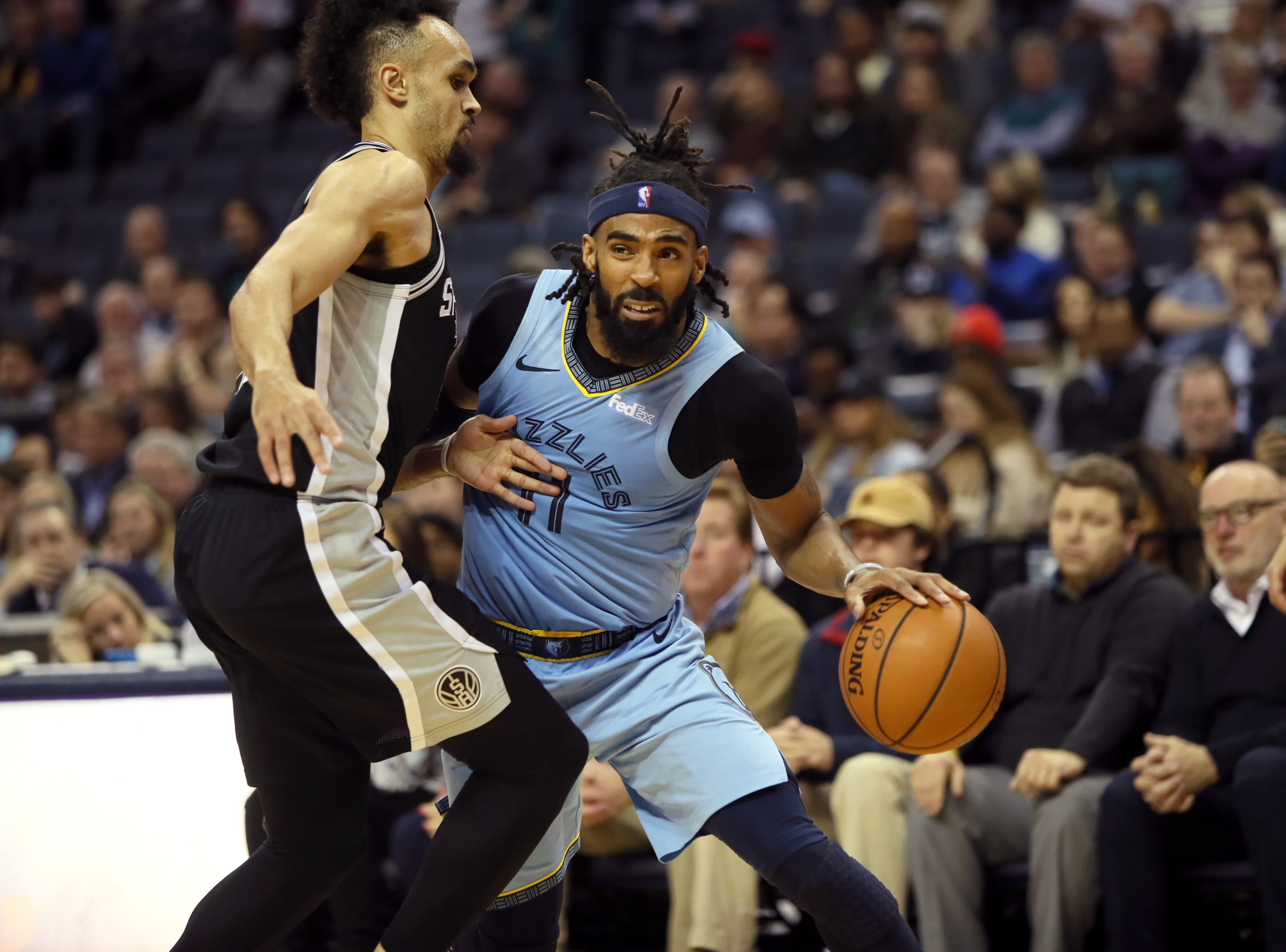 Memphis Grizzlies guard Mike Conley drives the basline past San Antonio Spurs defender Derrick White during their game at the FedExForum on Wednesday, Jan. 9, 2019.