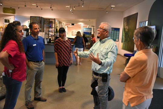 Dr. Jerry Jackson, center, draws a gathering for an impromptu talk at the ELC. The Rookery Bay Environmental Learning Center will host the Festival of Birds on Jan. 18 - 20, with field trips, lectures and activities to learn more about our avian neighbors.