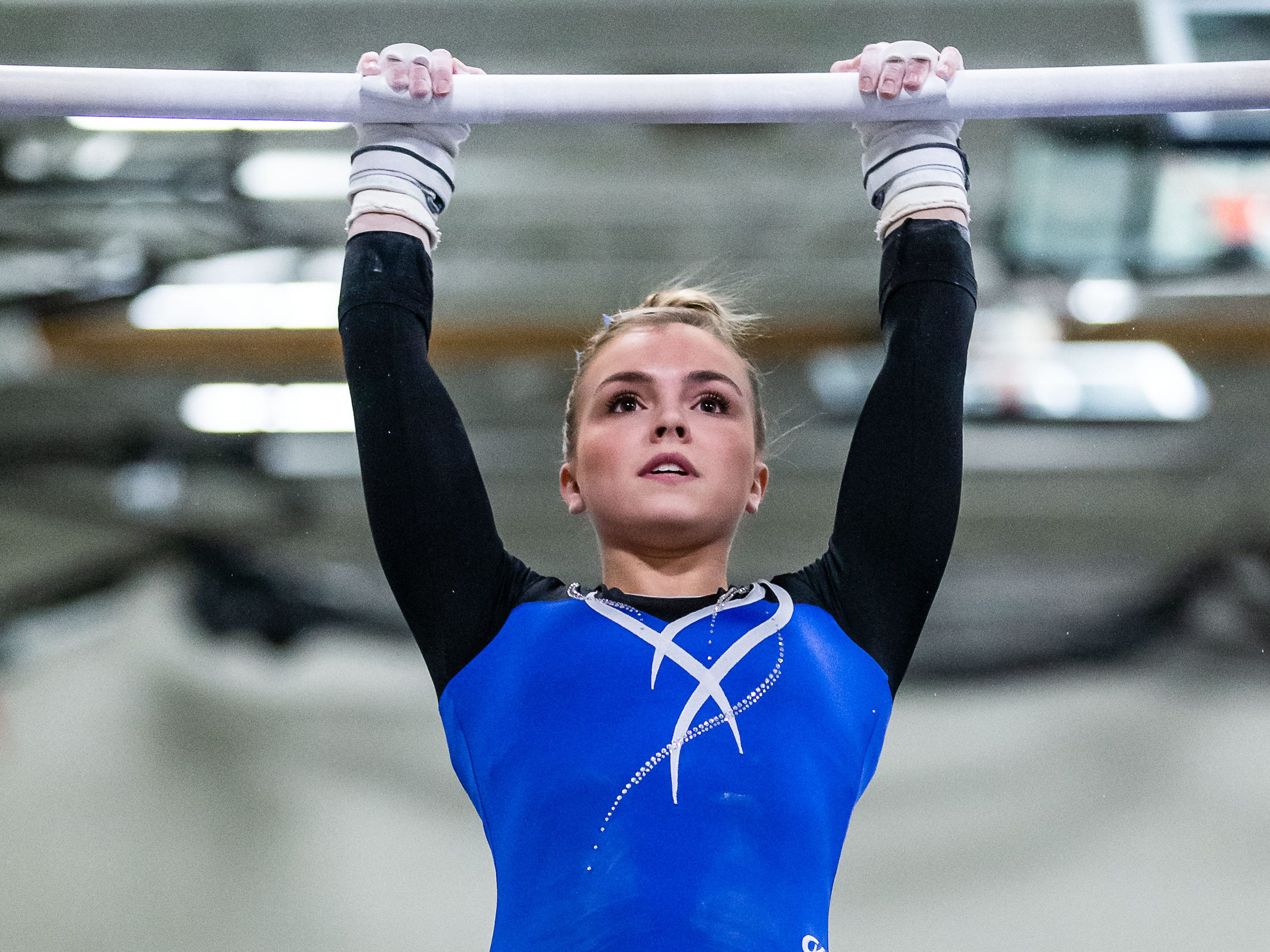 Nicolet gymnast Abbe Hansen competes on the bars during the meet at home against Whitefish Bay on Thursday, Jan. 3, 2019. Hansen placed third in the event with a score of 8.60.