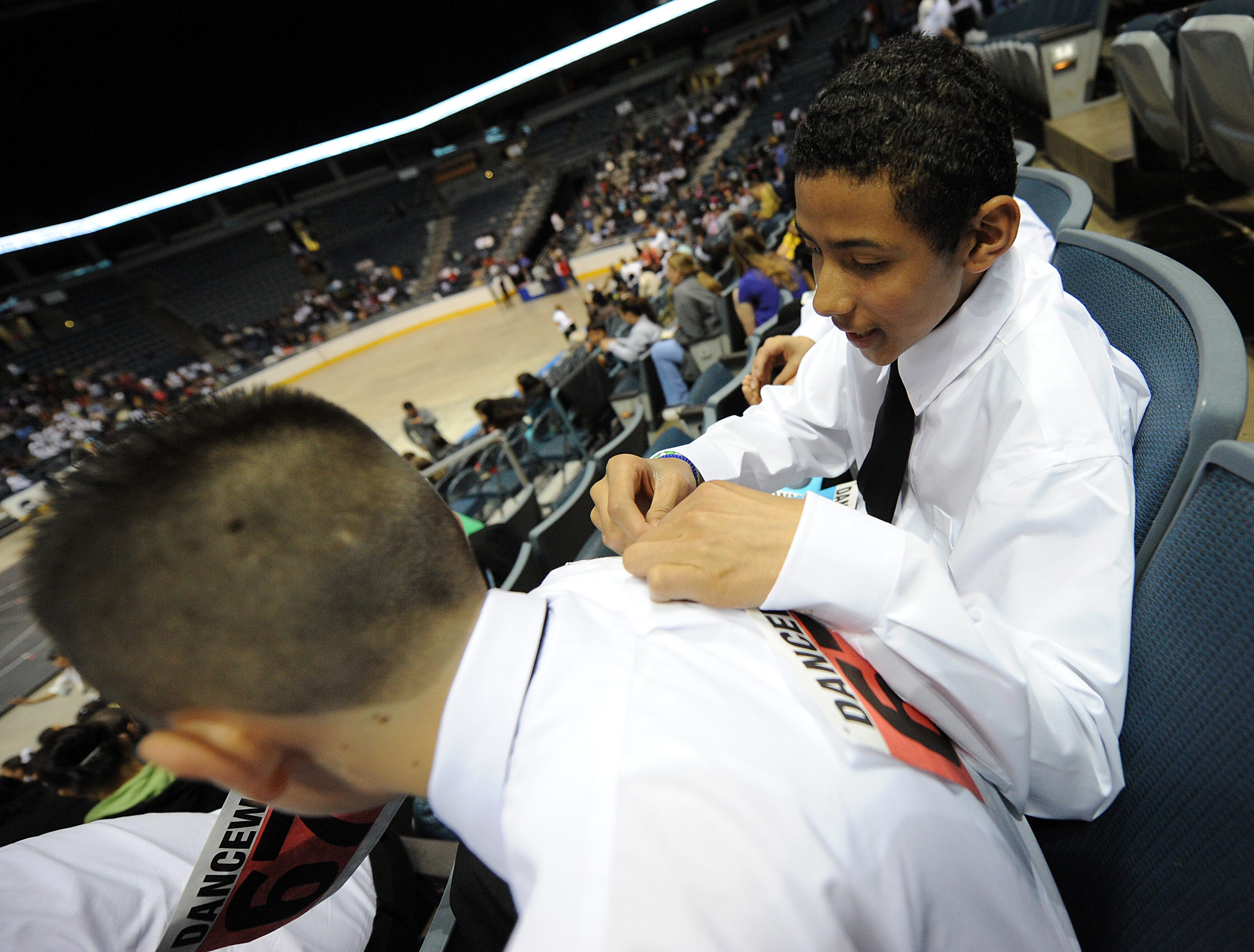 2010: Raymond Rodriguez (right) attaches a number to the back of Emmanuel Martinez shortly before the annual Mad Hot Ballroom and Tap Competition at the Bradley Center. Both Rodriguez and Martinez are sixth graders at Vieau School. More than 2,000 local students from 42 schools took part in a variety of dances and dance competitions.