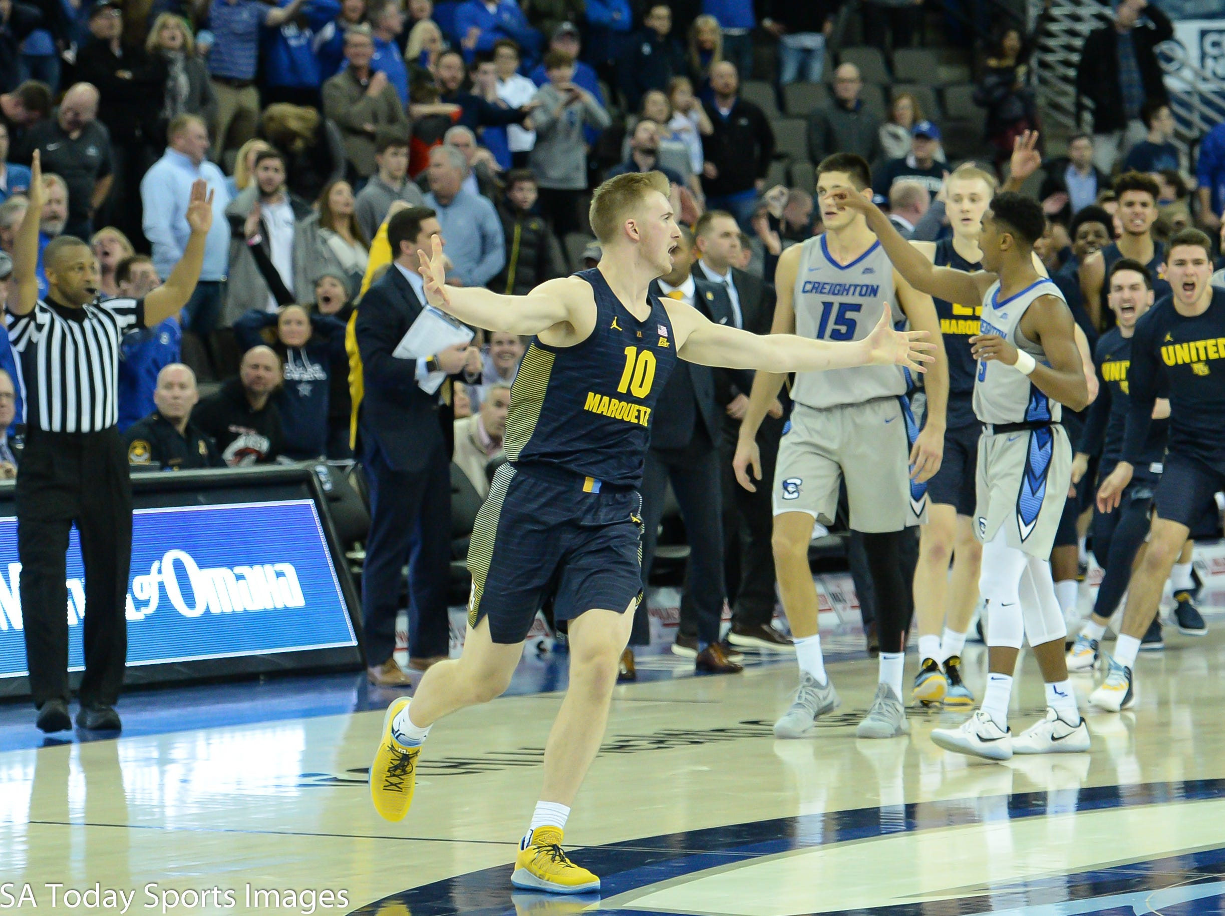 Jan 9, 2019; Omaha, NE, USA; Marquette Golden Eagles forward Sam Hauser (10) celebrates a last second shot to tie the game against the Creighton Bluejays in the second half at CHI Health Center Omaha. Mandatory Credit: Steven Branscombe-USA TODAY Sports