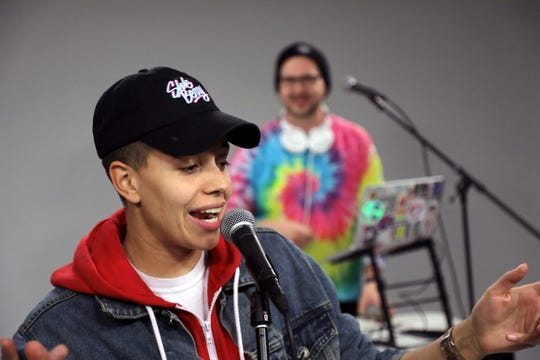 Rapper Shle Berry performs in the Journal Sentinel studios with support from DJ Alpine.