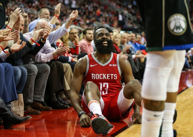 Rockets guard James Harden reacts after drawing a foul against the Bucks while putting up a three-pointer during the second quarter Wednesday night.