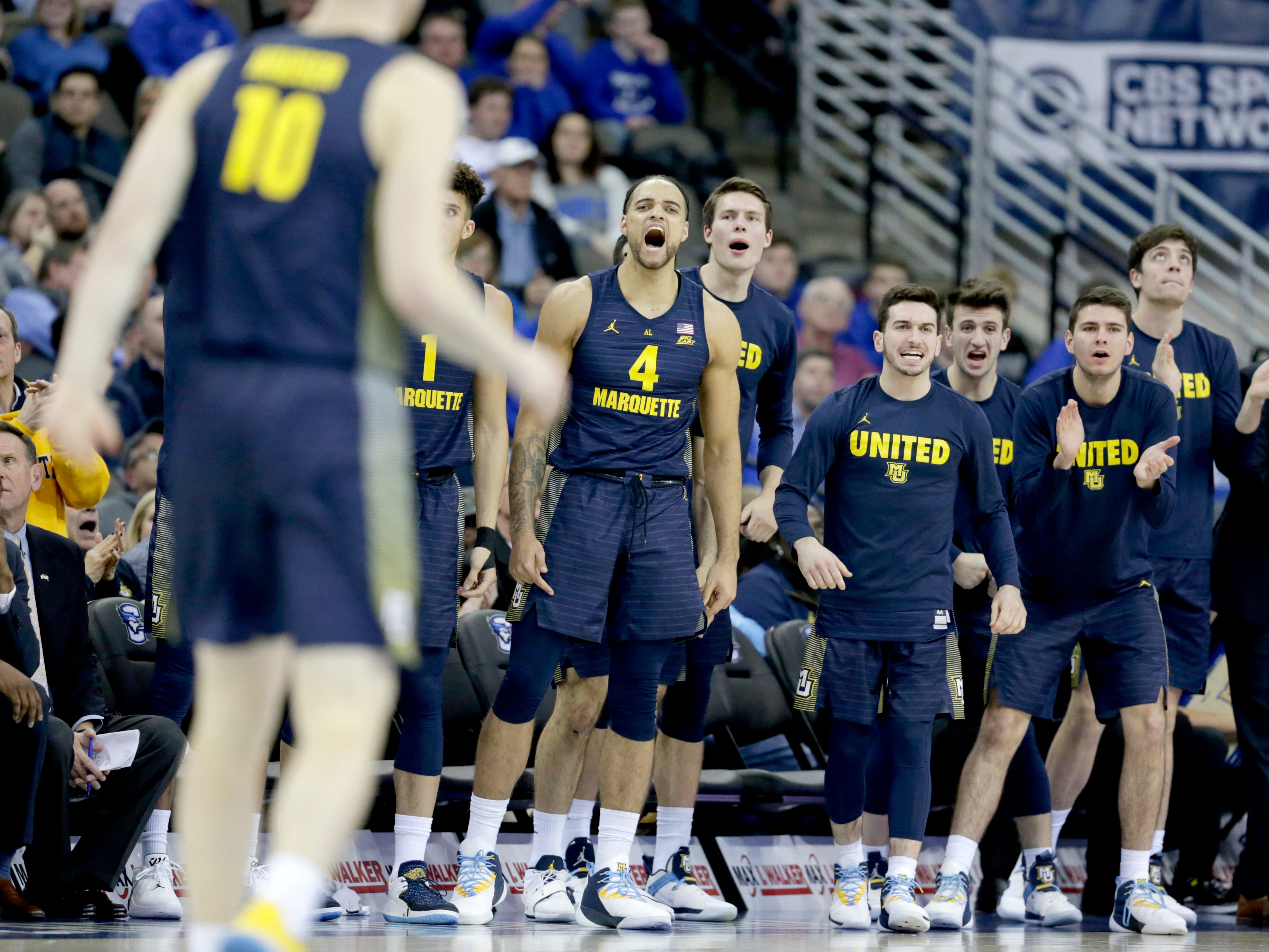 The Marquette bench cheers after Sam Hauser (10) hit a three-pointer against Creighton during the second half Wednesday.