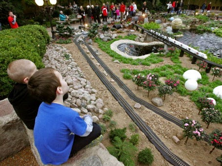 Aaron Theys of Germantown and Nolan Zanon of Colgate watch trains roll by in a Garden Train Show at the Mitchell Park Domes.