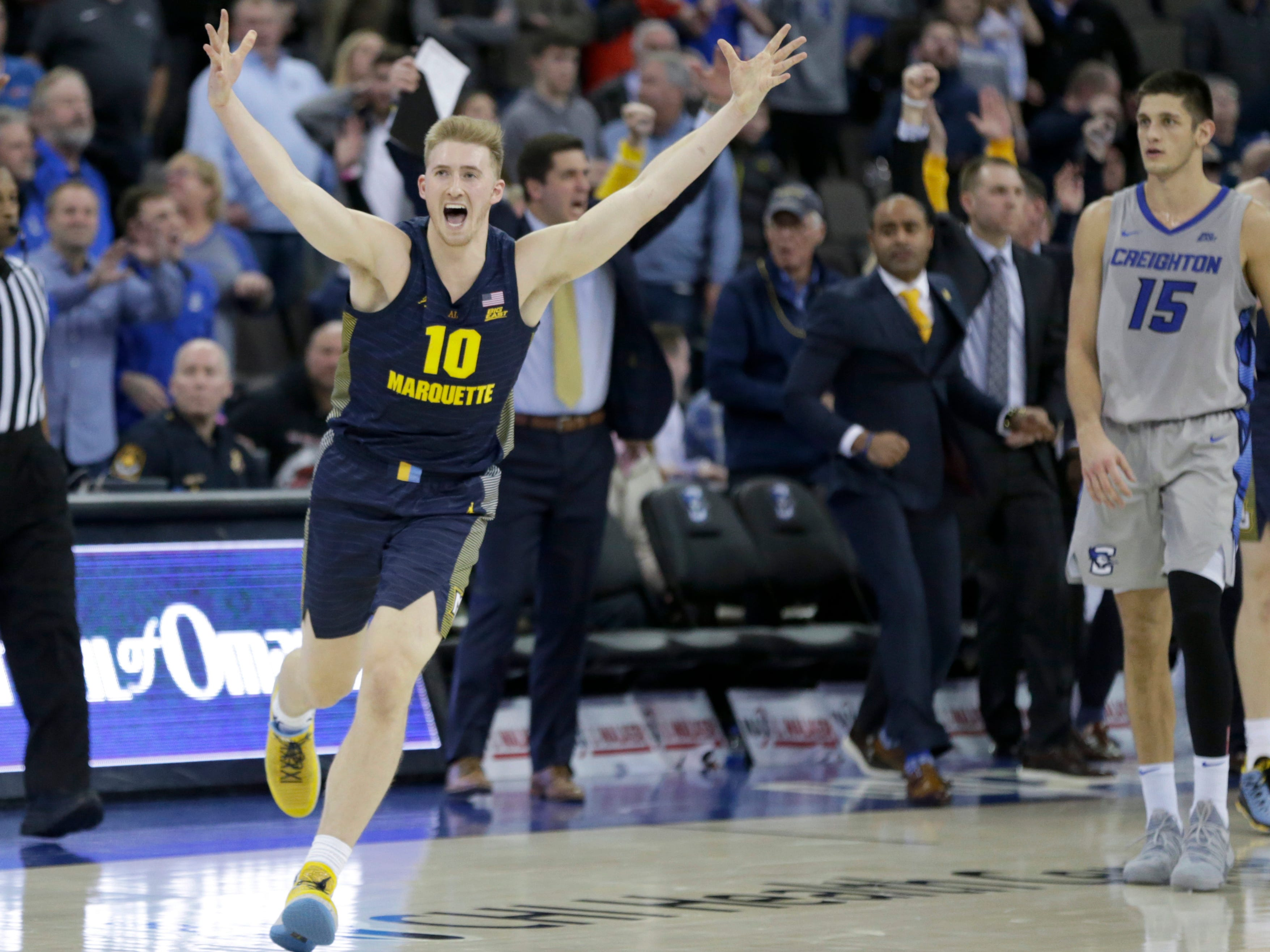 Sam Hauser of Marquette celebrates after hitting a buzzer-beating three-pointer at the end of regulation to send the Golden Eagles' game against Creighton into overtime.