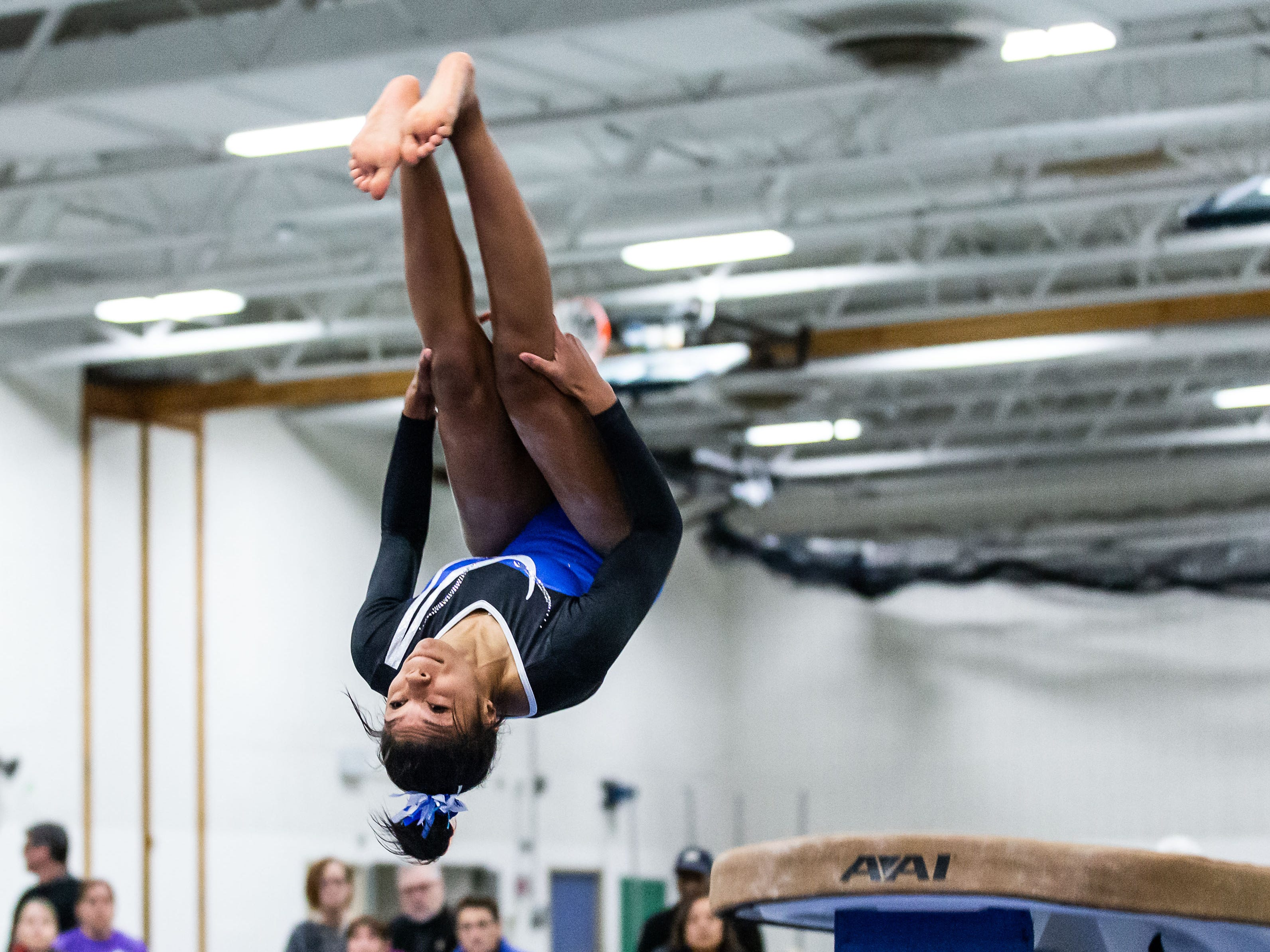 Nicolet gymnast Kynnedi Malone performs a backflip off the vault during the meet at home against Whitefish Bay on Thursday, Jan. 3, 2019. Kynnedi Malone placed second in the event with a score of 9.125.
