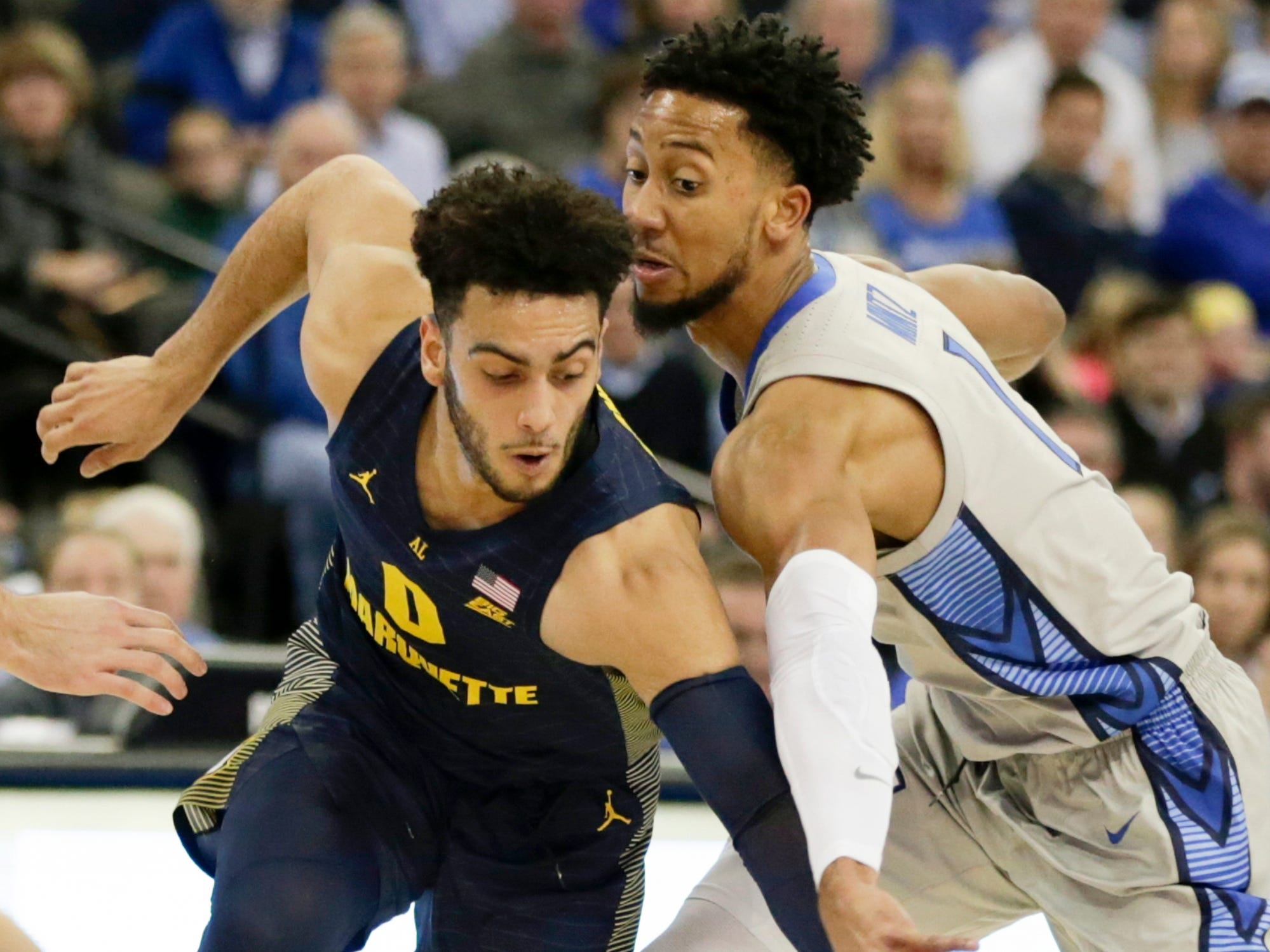 Marquette's Markus Howard tries to drive past Creighton's DavionMintz during the first half Wednesday night.