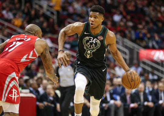 Jan 9, 2019; Houston, TX, USA; Milwaukee Bucks forward Giannis Antetokounmpo (34) dribbles the ball as Houston Rockets forward PJ Tucker (17) defends during the first quarter at Toyota Center. Mandatory Credit: Troy Taormina-USA TODAY Sports