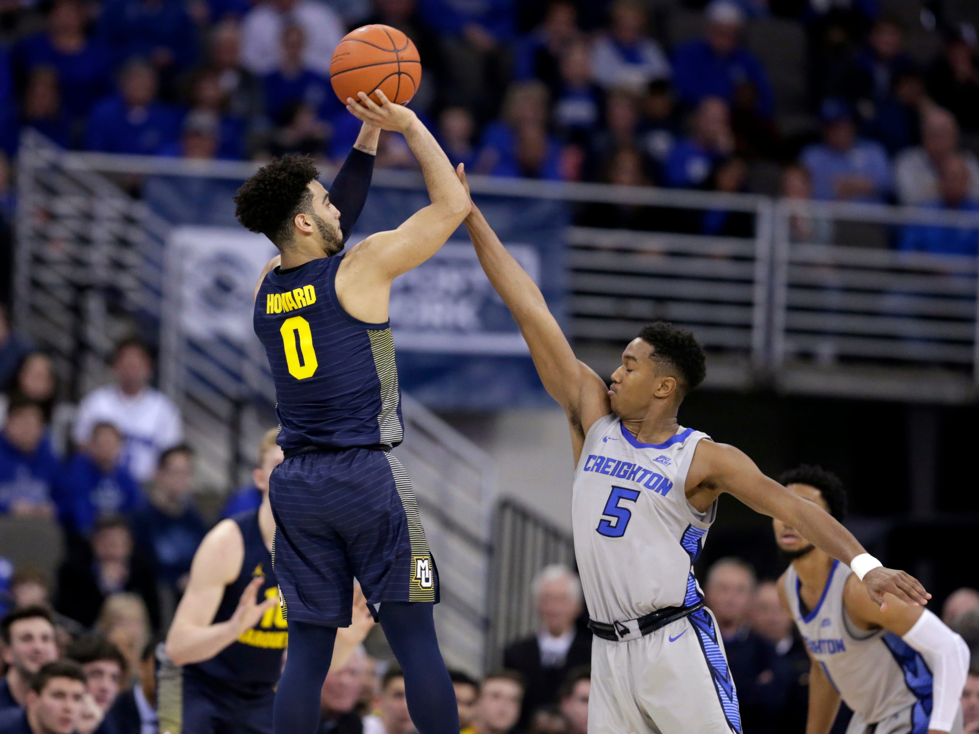 Marquette's Markus Howard launches a three-pointer over Creighton's Ty-ShonAlexander during the second half Wednesday night.
