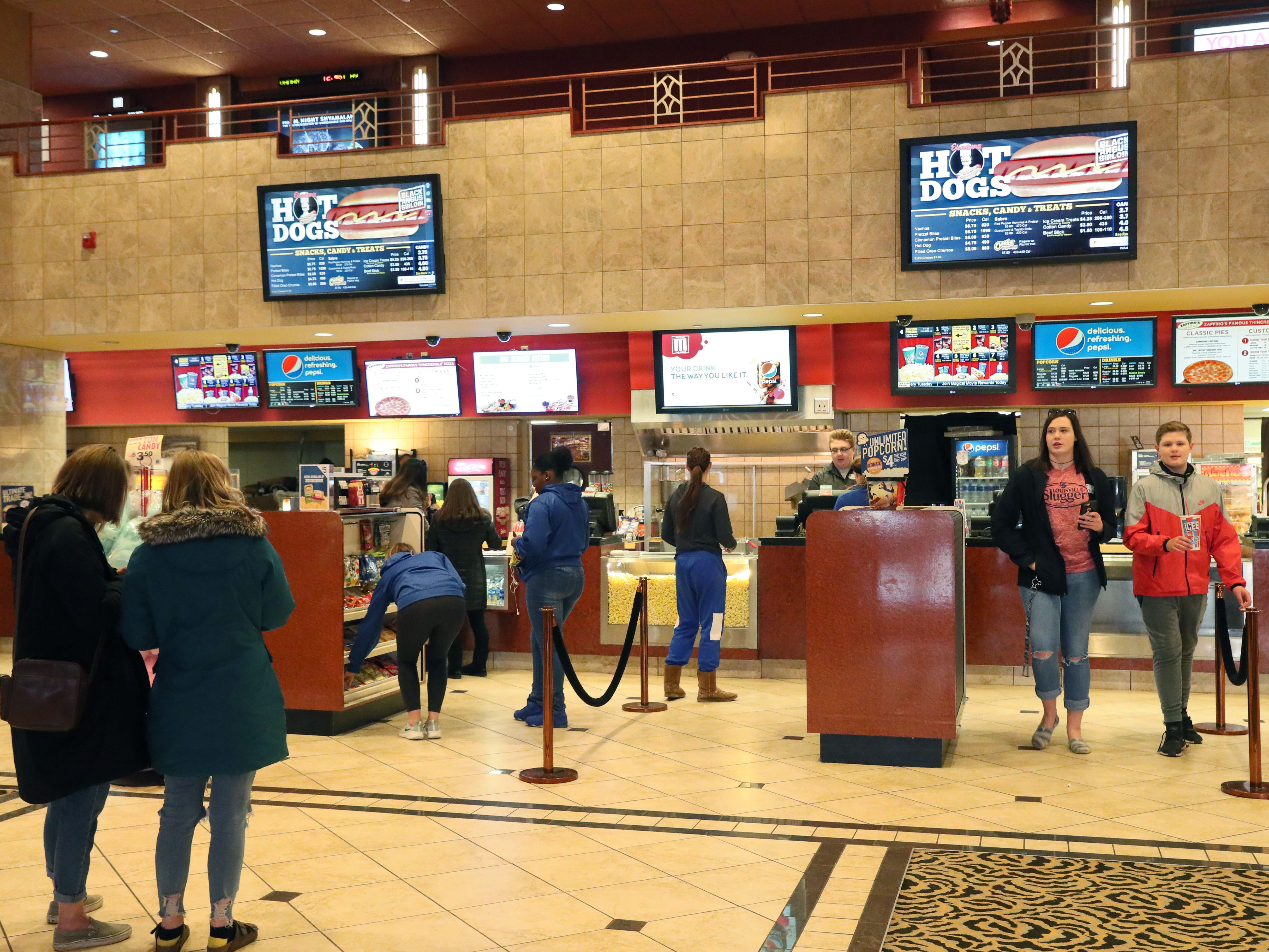 People buy food and drinks before the movie at the Marcus Majestic Cinema.