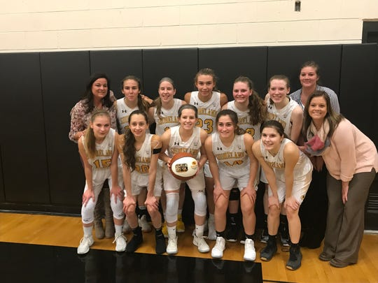 Shoreland Lutheran senior Chelby Koker (with ball) poses with her teammates and coaches after scoring her 2,000th point in a victory at home over Kenosha St. Joseph Tuesday Jan. 8, 2019.