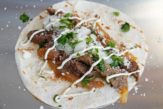 Beef flavored with the citrus calamansi is the basis for the Mexipino taco from Meat on the Street restaurant. It's topped with onion, cotija cheese and calamansi-cilantro aioli.