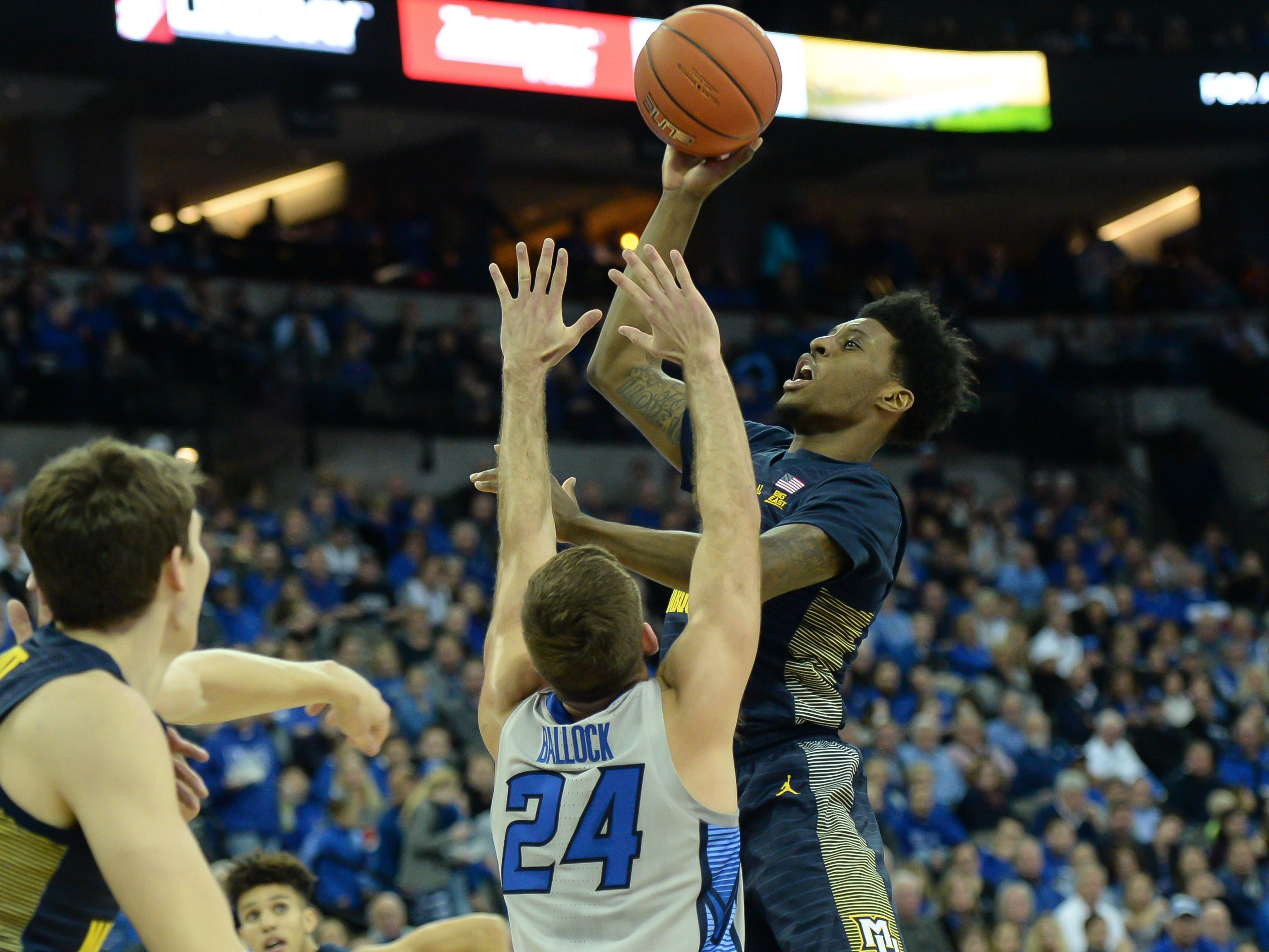 Marquette forward Sacar Anim goes up for a shot in the lane while being guarded by Creighton guard Mitch Ballock in the first half Wednesday.