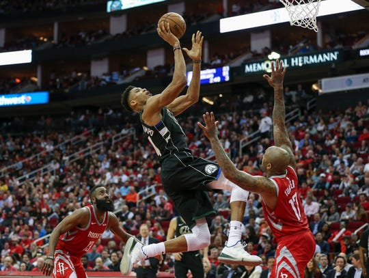 Giannis Antetokounmpo of the Bucks gets to the basket for a layup against Rockets forward PJ Tucker during the third quarter Wednesday night.