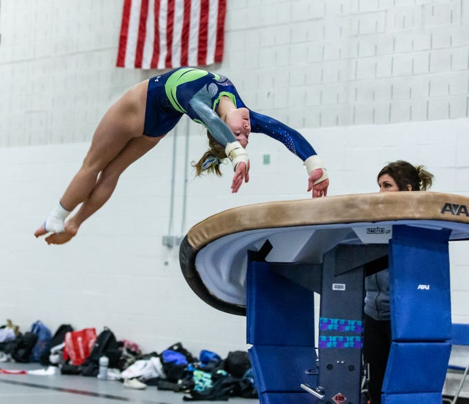 Whitefish Bay gymnast Addie Gallun performs a back handspring onto the vault during the meet at Nicolet on Thursday, Jan. 3, 2019. Gallun won the event with a score of 9.20.