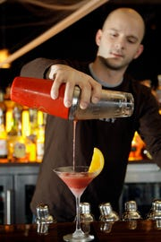 In 2009, bar manager Patrick Schmitt makes a cocktail at Whiskey Bar.